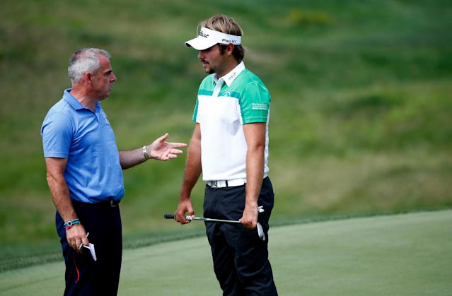 Paul McGinley talks with Victor Dubuisson of France during a practice round at Valhalla Golf Club in Louisville, Kentucky on August 6, 2014 prior to the PGA Championship (AFP Photo/Sam Greenwood)