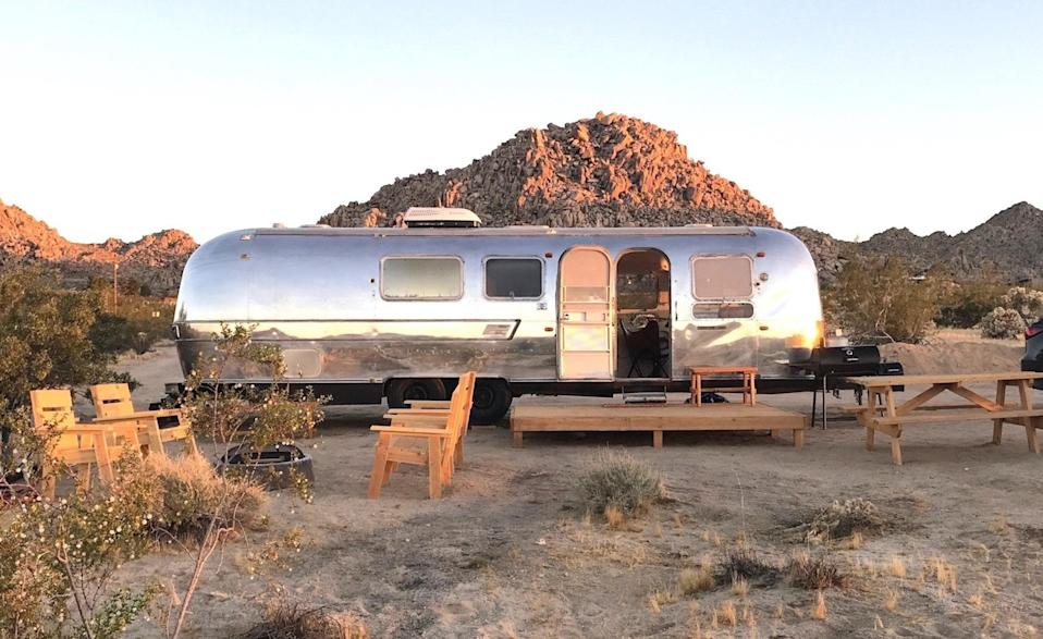"""<p>Set on five private acres just 15 minutes from the entrance to Joshua Tree National Park, this Airstream is for those that want to get off the grid. There's no Wi-Fi and no TV. There is, though, space for one full bed and two twin beds, a kitchen with a large, nearly full-size fridge, air conditioning for the hot desert days, and heating for the cool nights. Plus, there's lots of outdoor living space for enjoying the natural surroundings and <a href=""""https://www.cntraveler.com/story/joshua-tree-national-park-to-get-dark-sky-park-designation-for-stargazing?mbid=synd_yahoo_rss"""" rel=""""nofollow noopener"""" target=""""_blank"""" data-ylk=""""slk:incredible star-gazing"""" class=""""link rapid-noclick-resp"""">incredible star-gazing</a> that comes as a result of the trailer's limited light pollution.</p> <p><strong>Book now:</strong> <a href=""""https://airbnb.pvxt.net/gQOG2"""" rel=""""nofollow noopener"""" target=""""_blank"""" data-ylk=""""slk:From $59 per night, airbnb.com"""" class=""""link rapid-noclick-resp"""">From $59 per night, airbnb.com</a></p>"""