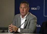 File-This May 6, 2015, file photo shows Mike Whan, Commissioner of the LPGA during a golf industry news conference at The Players Championship golf tournament in Ponte Vedra Beach, Fla. Whan brought a different perspective Tuesday, Oct. 22, 2019, at the LPGA Tours new BMW Ladies Championship in South Korea. Prize money for the women is growing at a rate Whan didn't think possible when he took over as commissioner in 2010. It's also growing for the men. (AP Photo/Chris O'Meara, File)