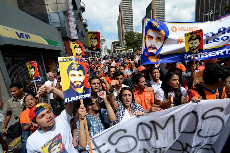 People demonstrate in support of imprisoned opposition leader Leopoldo Lopez, in Caracas on July 22, 2016
