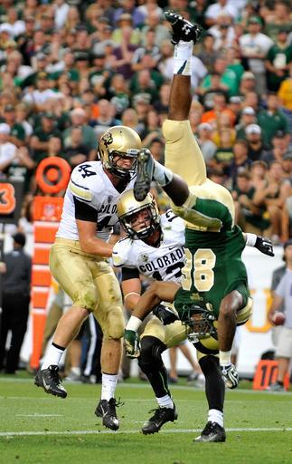 Colorado State tight end Kivon Cartwright (86) is upended by Colorado defensive back Parker Orms (13) and linebacker Addison Gillam (44) during the second half of an NCAA college football game, Sunday, Sept. 1, 2013, in Denver. (AP Photo/Jack Dempsey)
