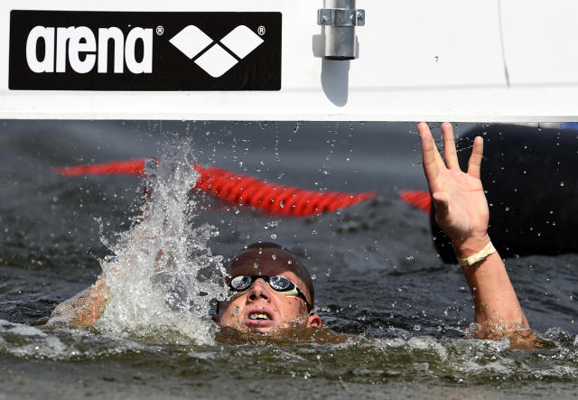 Ferry Weertman of The Netherlands wins the men's 10 km open water swimming event at the European Swimming Championships on August 14, 2014 at the Regattastrecke Gruenau in Berlin (AFP Photo/Tobias Schwarz)