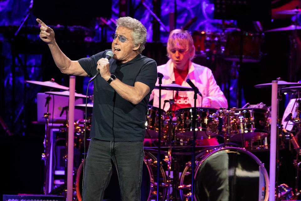"""Roger Daltrey of British rock band """"The Who"""" performs at the Toyota Center on the second leg of their Moving On! tour on September 25, 2019 in Houston, Texas. (Photo by SUZANNE CORDEIRO / AFP via Getty Images)"""