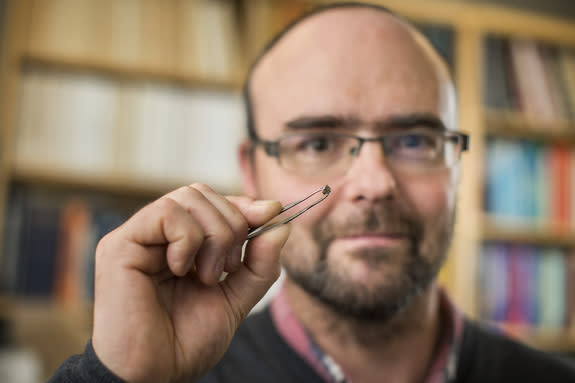 Graham Pearson holds a diamond that yields new clues about the presence of large amounts of water deep beneath the Earth.