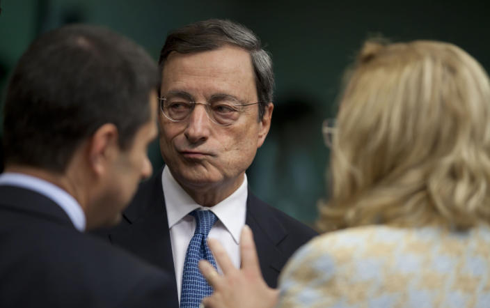 European Central Bank President Mario Draghi, center, speaks with Portugal's Finance Minister Vitor Gaspar, left, and Austria's Finance Minister Maria Fekter, right, during a meeting of eurogroup finance ministers in Brussels on Tuesday, Nov. 20, 2012. European Union officials will make a fresh try Tuesday to reaching a political accord on desperately needed bailout loans to Greece, an agreement that eluded them last week. (AP Photo/Virginia Mayo)