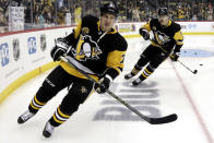 FILE - Pittsburgh Penguins' Sidney Crosby (87) and Evgeni Malkin (71) warm up before an NHL hockey game against the Florida Panthers in Pittsburgh, in this March 5, 2019, file photo. The faces around Sidney Crosby and Evgeni Malkin change. The expectations around the Pittsburgh Penguins and their two longtime stars do not. After an offseason of retooling the coaching staff and tweaking the roster, the Penguins are hoping to rebound following a second straight early playoff exit. (AP Photo/Gene J. Puskar/File)