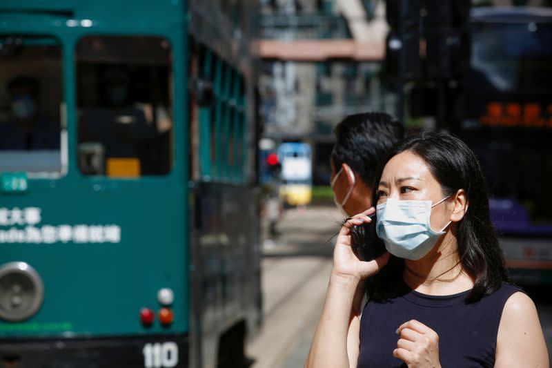 FILE PHOTO: A woman wears a surgical mask following the coronavirus disease (COVID-19) outbreak, in Hong Kong