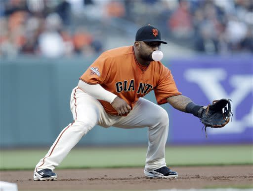 San Francisco Giants third baseman Pablo Sandoval blows a bubble during the first inning in the Giants's baseball game against the Arizona Diamondbacks on Friday, July 19, 2013, in San Francisco. (AP Photo/Marcio Jose Sanchez)