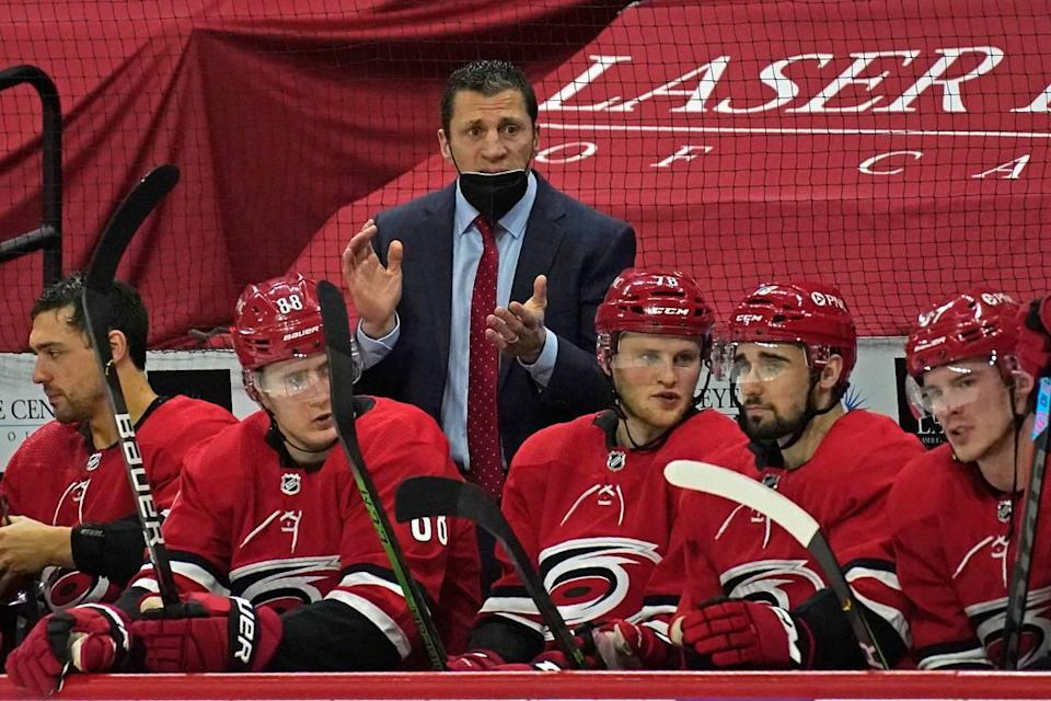 Carolina Hurricanes coach Rod Brind'Amour, top, encourages his team during the second period of an NHL hockey game against the Columbus Blue Jackets in Raleigh, N.C., Saturday, March 20, 2021. (AP Photo/Gerry Broome)