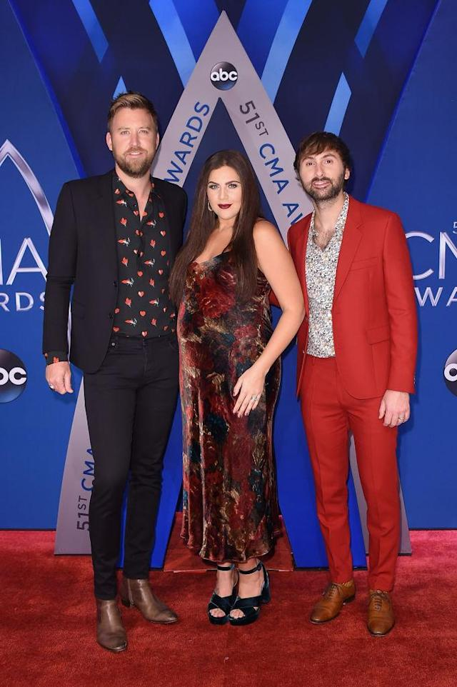 <p>The band was color-coordinated, with a hint of red in each of their looks. (Photo: Getty Images) </p>