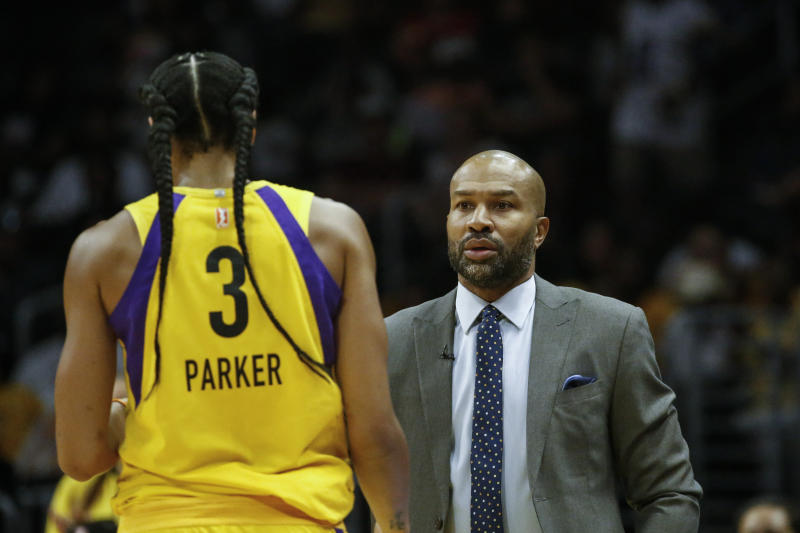 Los Angeles Sparks' head coach Derek Fisher talks to Los Angeles Sparks' Candace Parker (3) during a WNBA basketball game between Los Angeles Sparks and Minnesota Lynx in Los Angeles, Sunday, Sept. 8, 2019. The Sparks won 77-68. (AP Photo/Ringo H.W. Chiu)