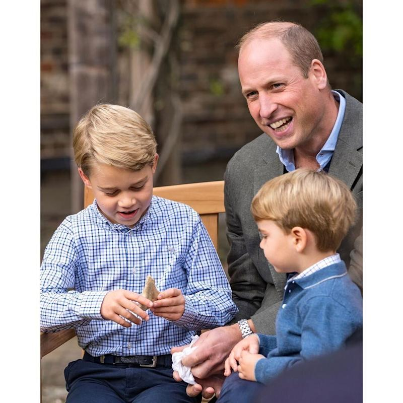 Prince George holds a shark tooth, as his father Prince William and brother Prince Louis look on. (Photo: Kensington Royal / Instagram)