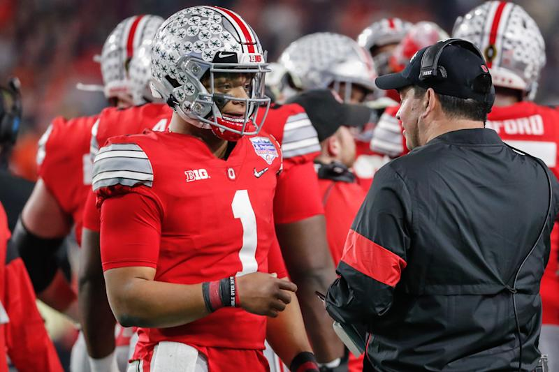 GLENDALE, AZ - DECEMBER 28: Ohio State Buckeyes quarterback Justin Fields (1) talks with Ohio State Buckeyes head coach Ryan Day during the Fiesta Bowl college football playoff semi final game between the Clemson Tigers and the Ohio State Buckeyes on December 28, 2019 at State Farm Stadium in Glendale, Arizona. (Photo by Kevin Abele/Icon Sportswire via Getty Images)