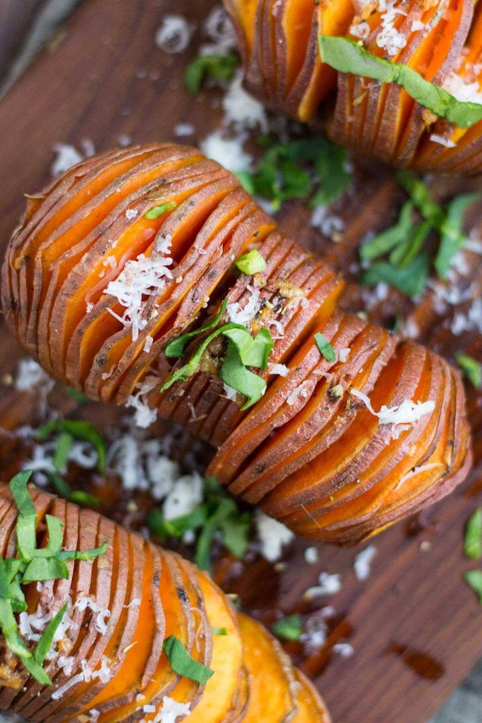 """<p>Cinnamon and nutmeg bring out the sweetness of the potatoes while basil and garlic add a savory bite.</p><p><strong>Get the recipe at <a href=""""https://simplerootswellness.com/detox-hasselback-sweet-potatoes/"""" rel=""""nofollow noopener"""" target=""""_blank"""" data-ylk=""""slk:Simple Roots Wellness"""" class=""""link rapid-noclick-resp"""">Simple Roots Wellness</a>.</strong></p><p><strong><strong><a class=""""link rapid-noclick-resp"""" href=""""https://www.amazon.com/Nordic-Ware-Natural-Aluminum-Commercial/dp/B0049C2S32/?tag=syn-yahoo-20&ascsubtag=%5Bartid%7C10050.g.877%5Bsrc%7Cyahoo-us"""" rel=""""nofollow noopener"""" target=""""_blank"""" data-ylk=""""slk:SHOP BAKING SHEETS"""">SHOP BAKING SHEETS</a></strong><br></strong></p>"""