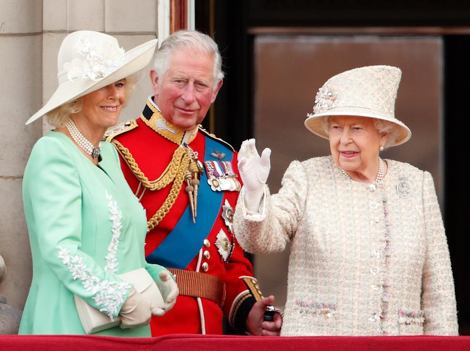 LONDON, UNITED KINGDOM - JUNE 08: (EMBARGOED FOR PUBLICATION IN UK NEWSPAPERS UNTIL 24 HOURS AFTER CREATE DATE AND TIME) Camilla, Duchess of Cornwall, Prince Charles, Prince of Wales and Queen Elizabeth II watch a flypast from the balcony of Buckingham Palace during Trooping The Colour, the Queen's annual birthday parade, on June 8, 2019 in London, England. The annual ceremony involving over 1400 guardsmen and cavalry, is believed to have first been performed during the reign of King Charles II. The parade marks the official birthday of the Sovereign, although the Queen's actual birthday is on April 21st. (Photo by Max Mumby/Indigo/Getty Images)