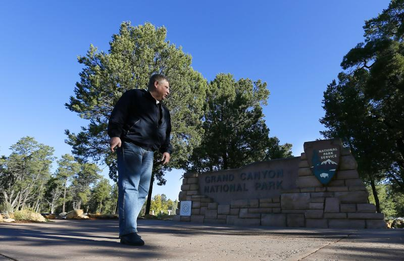 A frustrated Tommy Anderson, of Stockholm, Sweden, takes one last look at the park sign as he finds out the main entrance to Grand Canyon National Park remains closed to visitors due to the continued federal government shutdown on Friday Oct. 11, 2013, in Grand Canyon, Ariz. (AP Photo/Ross D. Franklin)