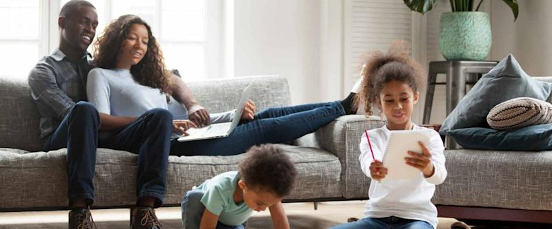 Happy black family spend free time together in living room