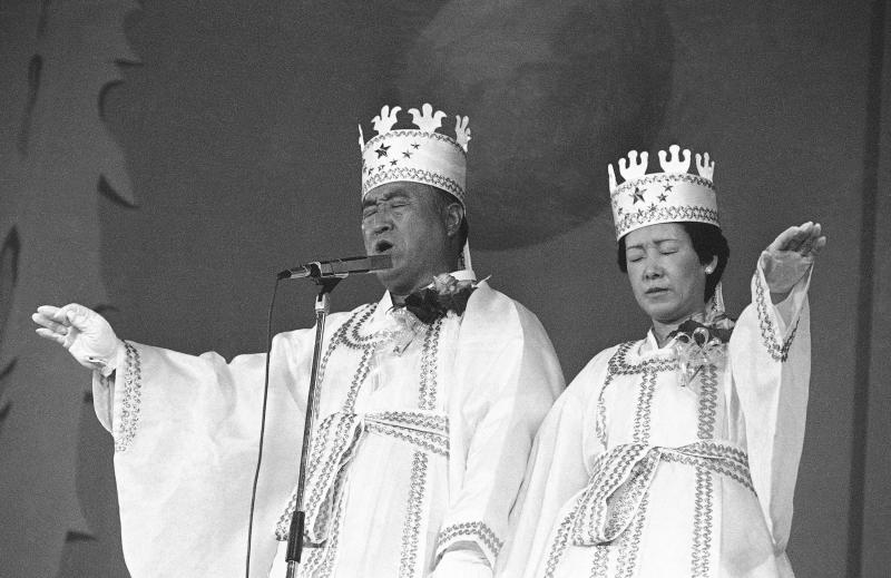 FILE - In this Oct. 14, 1982 file photo, Rev. Sun Myung Moon, left, and his wife Hak Ja Han, are shown during the traditional invocation of a blessing at a mass wedding in Seoul's Chamsil gymnasium where 6,000 couples from about 80 countries were married. Moon, self-proclaimed messiah who founded Unification Church, died at age 92 Monday, Sept. 3, 2012, church officials said. (AP Photo/File)