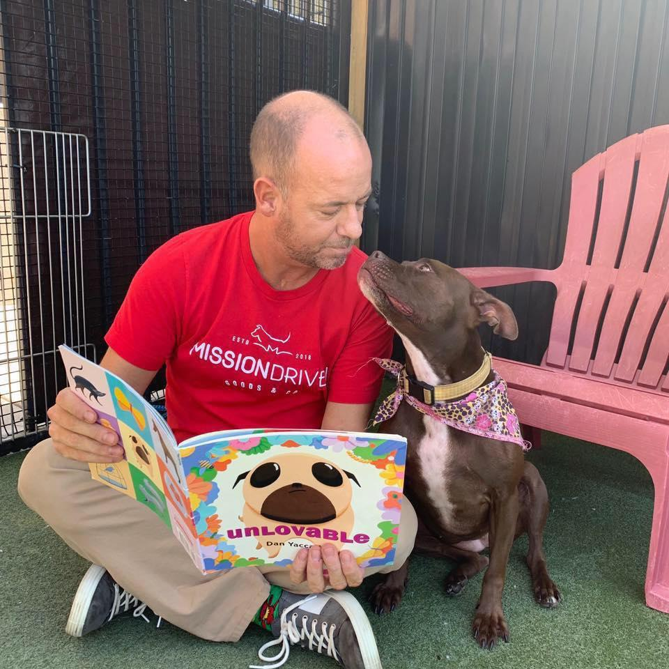 Scott Poore, a Kansas City animal advocate, has moved into his local animal shelter to help find a dog named Queen a forever home. (Credit: Scott Poore)
