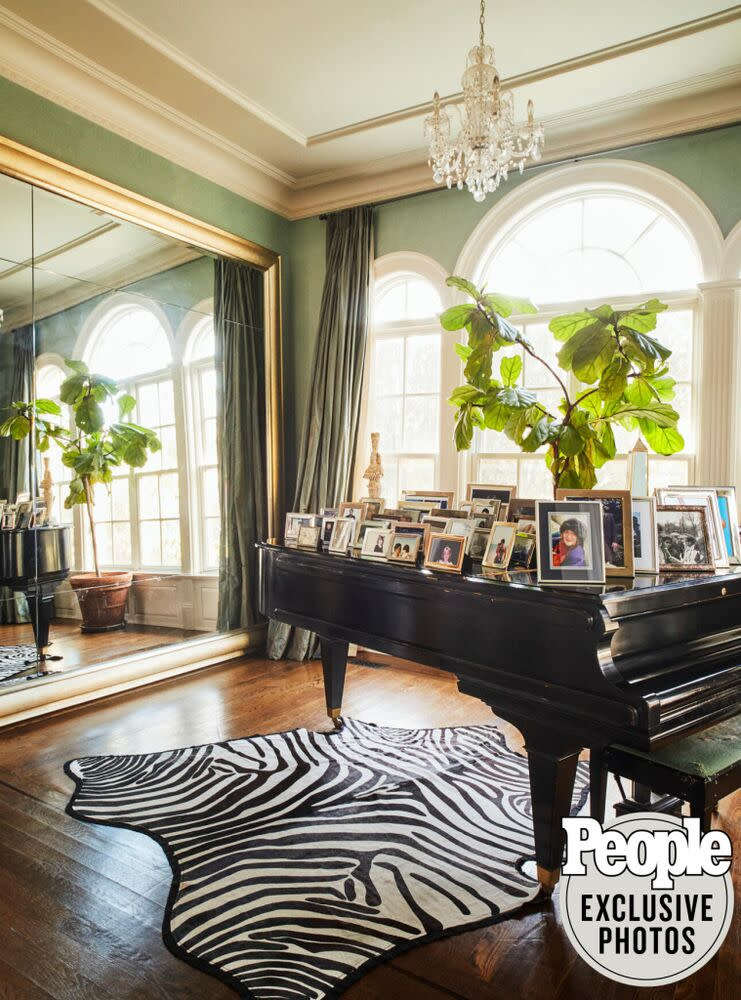 """""""It's Jersey— I gotta have animal print!"""" says Lisa of the rug under the grand piano, a family heirloom on which their four kids learned to play. 