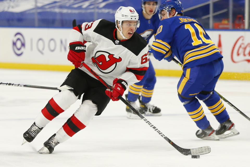 New Jersey Devils forward Jesper Bratt (63) skates with the puck during the first period of an NHL hockey game against the Buffalo Sabres, Saturday, Jan. 30, 2021, in Buffalo, N.Y. (AP Photo/Jeffrey T. Barnes)