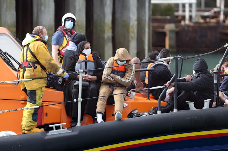 A group of people thought to be migrants are brought into Dover, Kent, by the RNLI following a small boat incident in the Channel. (Photo by Andrew Matthews/PA Images via Getty Images) (Photo: Andrew Matthews - PA Images via Getty Images)