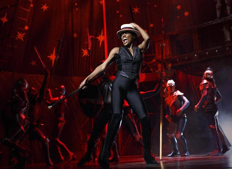 """FILE - This undated file image originally released by Boneau/Bryan-Brown shows Patina Miller during a performance of """"Pippin,"""" at Broadway's Music Box Theatre in New York. The revival of the Stephen Schwartz musical led by director Diane Paulus packs plenty of bang, lots of flips and real value for money: A ticket buys you not just a musical but also a trip to the circus. There are fire jugglers, teeterboards, knife throwing and contortionists, as well as Bob Fosse-style dancing and great performances. (AP Photo/Boneau/Bryan-Brown, Joan Marcus)"""