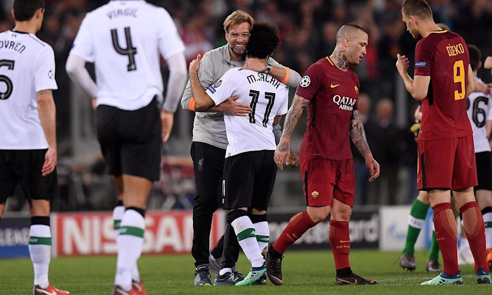 Jürgen Klopp celebrates with Mohamed Salah after Liverpool booked their place in the Champions League with victory in Rome.