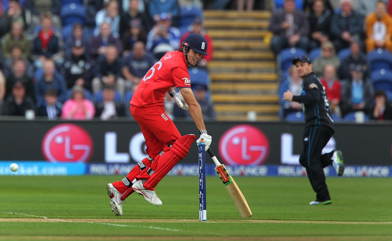 England captain Alastair Cook makes his ground as New Zealand captain Brendon McCullum tries to run him out with a throw at the stumps, at the SWALEC Stadium, Cardiff.