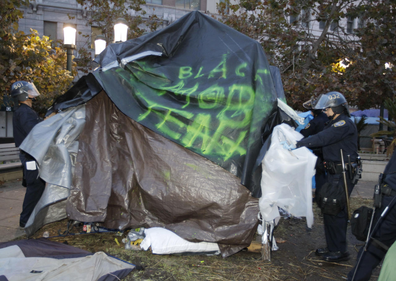 Police break up an encampment for a Occupy Wall Street demonstration in Oakland, Calif., Monday, Nov. 14, 2011. Police in Oakland began clearing out a weeks-old encampment early Monday after issuing several warnings to Occupy demonstrators. (AP Photo/Paul Sakuma)