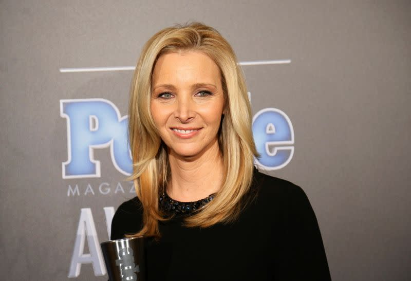 """FILE PHOTO: Actress Lisa Kudrow poses backstage with her award for TV Performance of the Year for """"The Comeback"""" at the People Magazine Awards in Beverly Hills"""