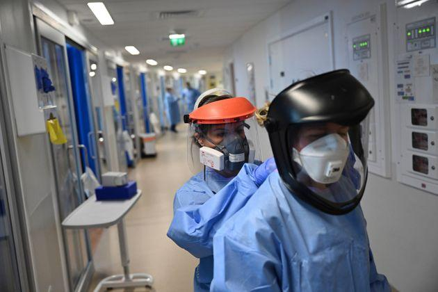 Medics wear PPE as they care for patients with coronavirus in the intensive care unit at the Royal Papworth Hospital in Cambridge