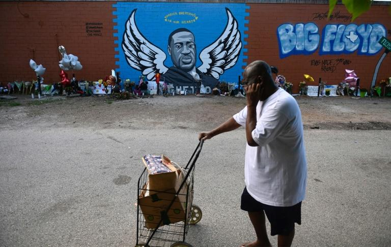 A man walking past a mural commemorating the life and death of George Floyd in his home town of Houston, Texas on June 8,2020 (AFP Photo/Andrew CABALLERO-REYNOLDS)
