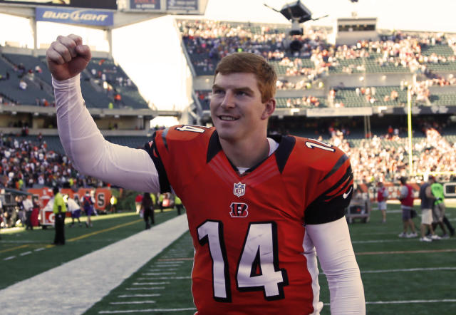 Cincinnati Bengals quarterback Andy Dalton runs off the field after they defeated the Green Bay Packers 34-30 in an NFL football game, Sunday, Sept. 22, 2013, in Cincinnati. (AP Photo/David Kohl)
