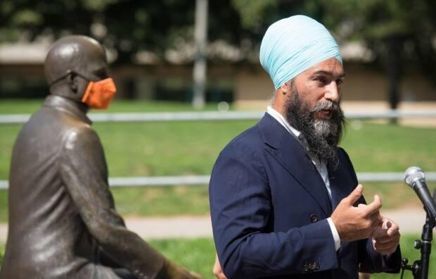 NDP Leader Jagmeet Singh, at the Jack Layton Monument in Toronto, responds to a question during an August press conference marking the 60th anniversary of the NDP. (The Canadian Press/Tijana Martin - image credit)