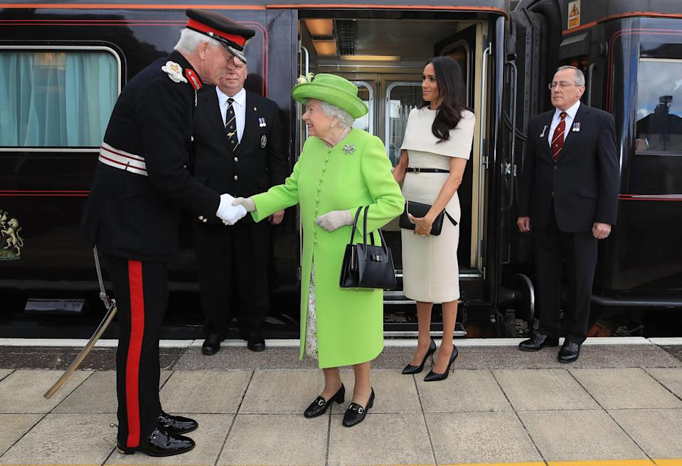 Her Majesty invited Meghan Markle on the royal train today for their debut joint engagement in Cheshire [Photo: Getty]