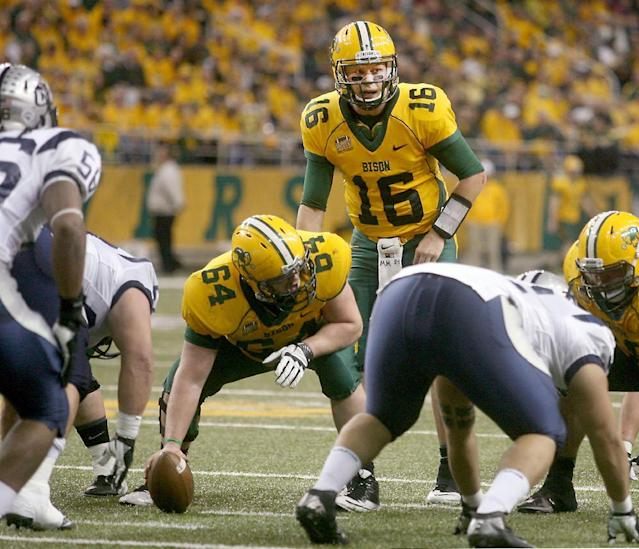 North Dakota State quarterback Brock Jensen (16) looks at the defense during the first half of an NCAA Football Championship Subdivision semifinal game against New Hampshire on Friday, Dec. 20, 2013, at the Fargodome in Fargo, N.D. (AP Photo/Bruce Crummy)