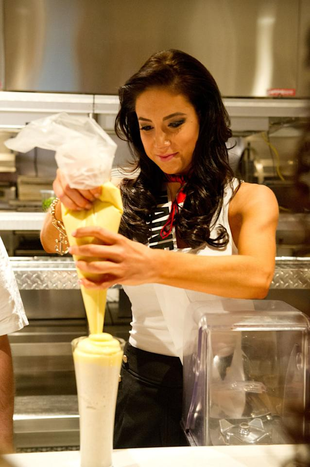 Miss Maine USA 2013, Ali Clair, makes a pudding milkshake at BurGR in Las Vegas, Nevada on Wednesday June 5, 2013.