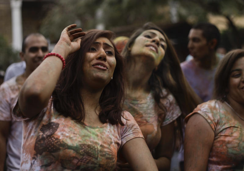 "In this Saturday, April 6, 2013 photo, Egyptian ladies dance during a ""Mahraganat"" Arabic word for ""festivals,"" concert by music singers, in Cairo, Egypt. A new musical sound emerged from the underground in Egypt since the country's 2011 revolution, a rapid-fire electronic beat, mixed with hypnotic rhythms drawn from religious festivals and fired up with auto-tuned vocals. Besides getting club crowds dancing all night long, it has given a rebellious voice to long marginalized youth, telling stories of everyday life in beaten-down neighborhoods of Cairo. ( AP Photo/Nariman El-Mofty)"