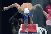 Caeleb Dressel of the United States starts in his heat of the men's 100-meter butterfly at the 2020 Summer Olympics, Thursday, July 29, 2021, in Tokyo, Japan. (AP Photo/Matthias Schrader)