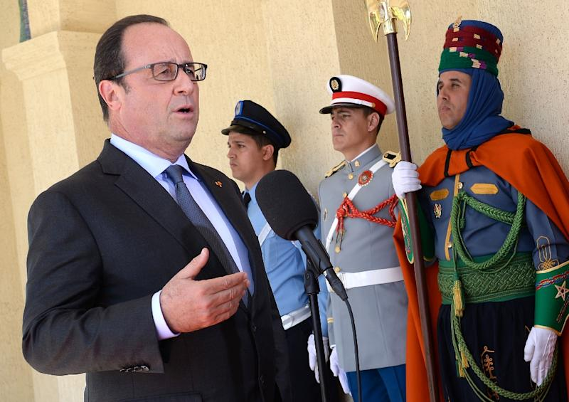 French President Francois Hollande speaks to journalists upon his arrival at Ibn Battouta airport in Boukhalef, 10km south of Tangier, on September 19, 2015