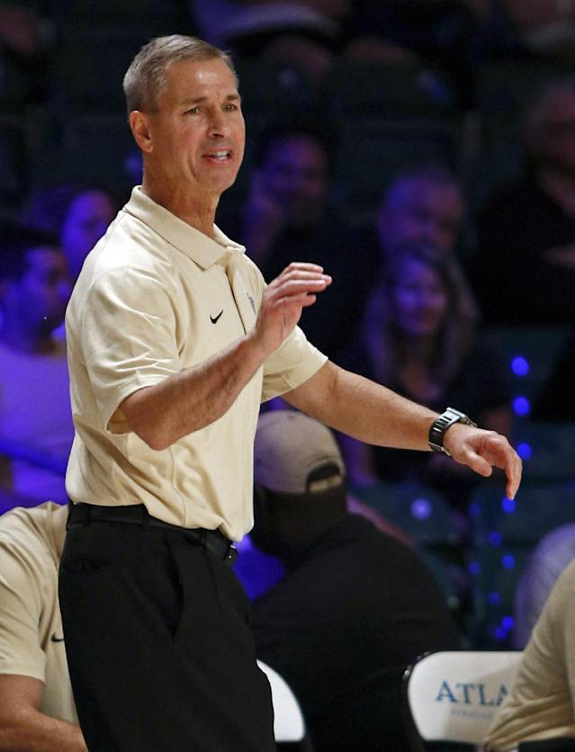 Wake Forest head coach Jeff Bzdelik gives instructions to his players from the sidelines during the first half of an NCAA college basketball game against Tennessee in Paradise Island, Bahamas, Saturday, Nov. 30, 2013. (AP Photo/Bahamas Visual Services, Tim Aylen)