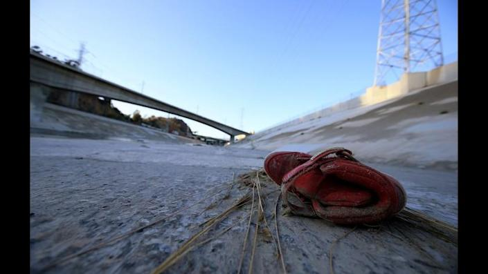 An old sneaker rests in the bed of the Los Angles River near downtown.