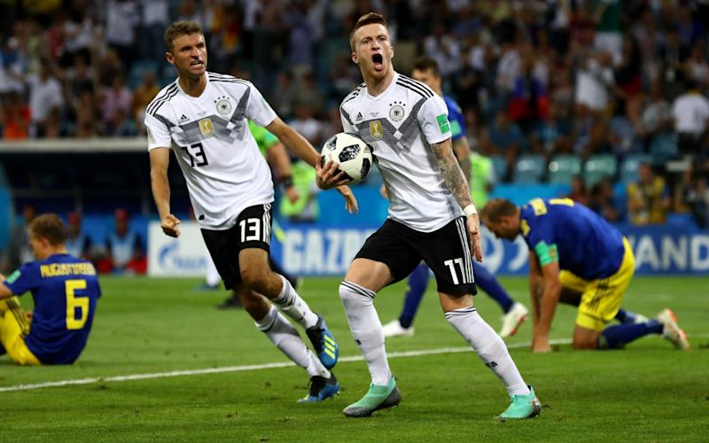 Germany's Marco Reus celebrates with Thomas Mueller after scoring his side's opening goal against Sweden last night. - Getty Images Europe