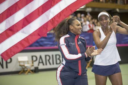 Feb 11, 2018; Asheville, NC, USA;Coco Vandeweghe (USA), Venus Williams (USA), Serena Williams (USA) and Lauren Davis (USA) celebrate the USA the Fed Cup tie against the Netherlands at U.S. Cellular Center. Mandatory Credit: Susan Mullane-USA TODAY Sports