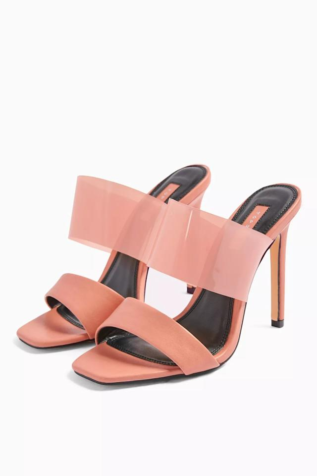 "<p>We're so into these cool <a href=""https://www.popsugar.com/buy/Topshop-Stella-Blush-Pink-Transparent-Mules-556922?p_name=Topshop%20Stella%20Blush%20Pink%20Transparent%20Mules&retailer=us.topshop.com&pid=556922&price=55&evar1=fab%3Aus&evar9=46054622&evar98=https%3A%2F%2Fwww.popsugar.com%2Ffashion%2Fphoto-gallery%2F46054622%2Fimage%2F47309506%2FTopshop-Stella-Blush-Pink-Transparent-Mules&list1=shopping%2Csandals%2Cshoes%2Caccessories%2Cspring%2Cspring%20fashion%2Cwide%20feet&prop13=api&pdata=1"" rel=""nofollow"" data-shoppable-link=""1"" target=""_blank"" class=""ga-track"" data-ga-category=""Related"" data-ga-label=""https://us.topshop.com/en/tsus/product/shoes-70484/wide-fit-shoes-7472648/wide-fit-stella-blush-pink-transparent-mules-9696944"" data-ga-action=""In-Line Links"">Topshop Stella Blush Pink Transparent Mules</a> ($55).</p>"