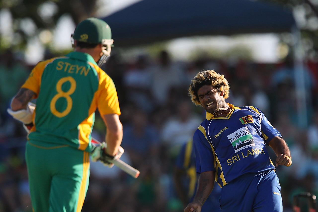 Lasith Malinga of Sri Lanka (R) celebrates the wicket of Dale Steyn of South Africa on January 11, 2012 during the first one-day International match between South Africa and Sri Lanka at the Boland Park Stadium in Paarl. AFP PHOTO/ RON GAUNT (Photo credit should read RON GAUNT/AFP/Getty Images)
