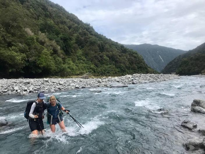 Ashley Ludack, left, and Claire Lewinski cross the Deception River in New Zealand during their thru-hike of the Te Araroa trail. Lewinski, an Idaho native, hiked the trail as part of her recovery from a traumatic brain injury.