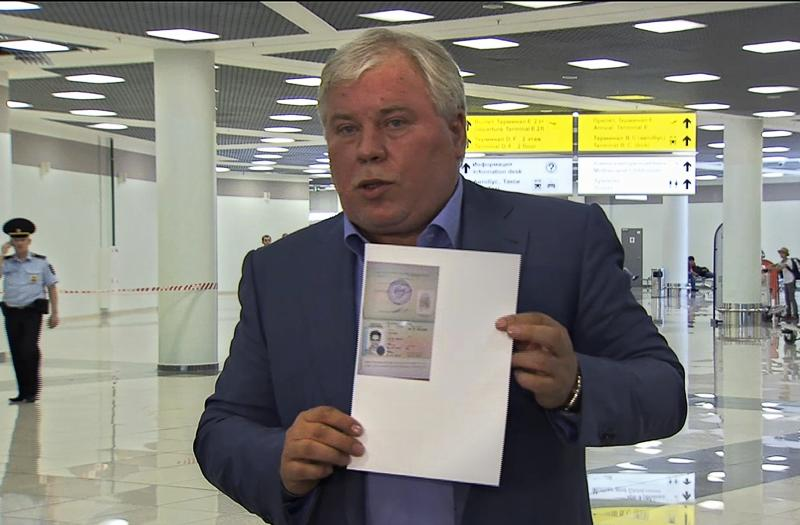 In this image taken from Associated Press Television shows, Russian lawyer Anatoly Kucherena showing a temporary document to allow Edward Snowden cross the border into Russia while speaking to the media after visiting National Security Agency leaker Edward Snowden at Sheremetyevo airport outside Moscow, Russia, on Thursday, Aug. 1, 2013. National Security Agency leaker Edward Snowden has received asylum in Russia for one year and left the transit zone of Moscow's airport, his lawyer said Thursday. Kucherena said after meeting with the fugitive at Moscow's Sheremetyevo airport, where he was stuck since his arrival from Hong Kong on June 23, that he handed him the papers proving his status. Kucherena said that Snowden's whereabouts will be kept secret for security reasons. (AP Photo/Associated Press Television)