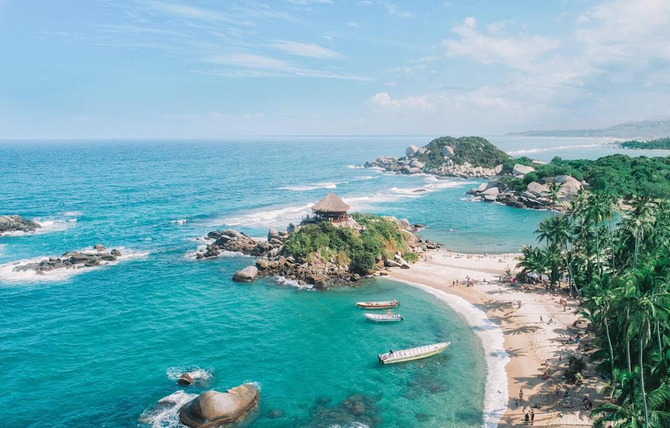 Colombia's Tayrona National Park offers white beaches fringed by lush jungle - Getty
